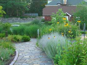 Stone path lined with perennials and grasses atStepping Stones Museum for Children